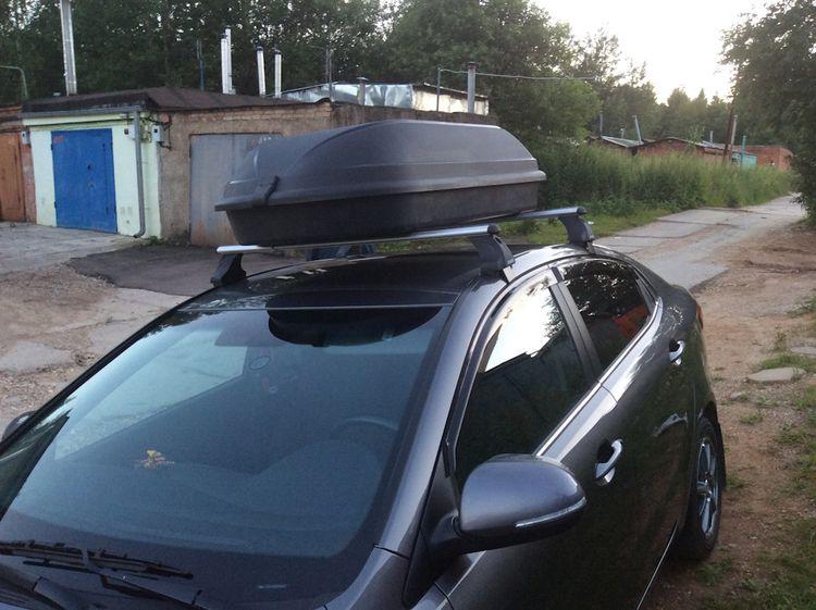 Устанавливаем багажник на крышу Киа Рио